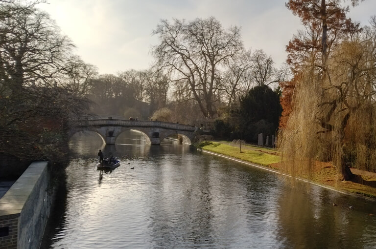 A view over the River Cam, with punters in the sunshine.